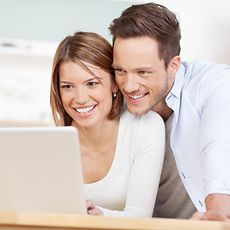 Two People in front of a PC