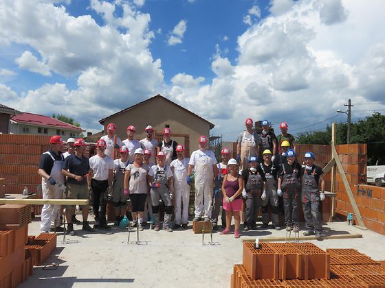 volunteers at a construction site in Romania